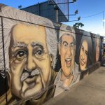 Muro da Barra com rostos de artistas baianos grafitados | Presente para Salvador